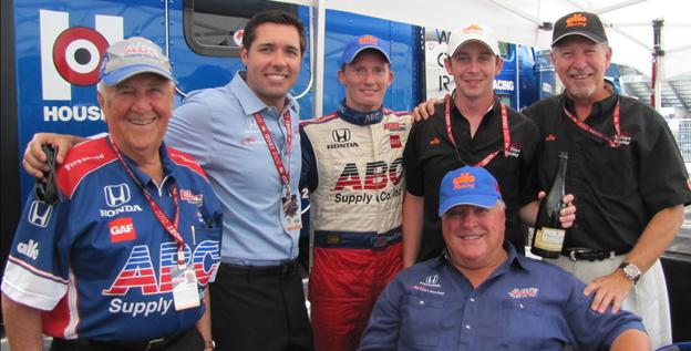 From left to right, Jim Greer, Larry Foyt, Mike Conway, A.J. Foyt (sitting), Ryan Westman and his father Kurt, president of Alfe Heat Treating celebrate after Conway's third-place finish Sunday in Toronto.