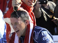 A.J. Allmendinger gets doused by Lucas Luhr in victory lane after winning the Grand-Am Rolex 24 at Daytona in late January. Allmendinger is shown on a promotional video taking a &quot;power shot&quot; before and after the win.