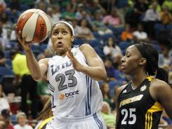 Minnesota Lynx forward Maya Moore goes up to the basket against Tulsa Shock forward Glory Johnson in the second half.
