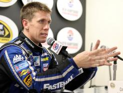 Roush Fenway driver Carl Edwards talks to the news media Friday at New Hampshire Motor Speedway.
