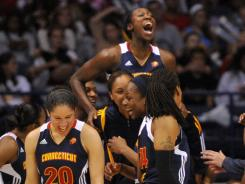 Connecticut Sun players celebrate after defeating the Chicago Sky in overtime.