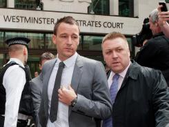 Chelsea defender John Terry leaves Westminster Magistrates court in London on Friday, after being cleared of racially abusing Queens Park Rangers' Anton Ferdinand.