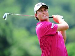 U.S. Open champion Webb Simpson withdrew from the British Open on Friday as he awaits the birth of his second child.