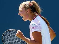 Yanina Wickmayer of Belgium celebrates a point against Marion Bartoli of France during the Bank of the West Classic at Stanford University Taube Family Tennis Stadium.