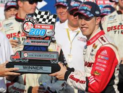 Brad Keselowski holds the trophy for winning the F.W. Webb 200 at New Hampshire Motor Speedway.