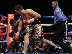 Danny Garcia lands a right hand to the head of Amir Khan during their junior welterweight title fight at Mandalay Bay on Saturday night. Garcia won by 4th-round TKO.
