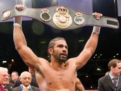 David Haye raises his belt trophy after winning the WBO International and WBA Intercontinental Heavyweight Championship fight at the West Ham football stadium in east London.