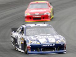 NASCAR Sprint Cup Series drivers Jimmie Johnson (48) and David Stremme (back) practice Saturday for the Lenox Industrial Tools 301 at New Hampshire Motor Speedway.