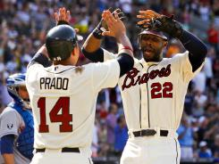 Braves right fielder Jason Heyward celebrates with shortstop Martin Prado after scoring a run against the New York Mets at Turner Field.