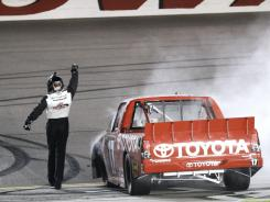 Timothy Peters celebrates on the track after winning the NASCAR Trucks American Ethanol 200.
