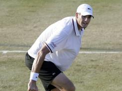 Top-seed John Isner hits a return to Ryan Harrison during his semifinal match victory at the Hall of Fame Tennis Championships. The American will face Lleyton Hewitt of Australia in the final.