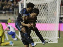 Philadelphia Union's Carlos Valdes, right, and Sheanon Williams celebrate Valdes' goal in the second half.