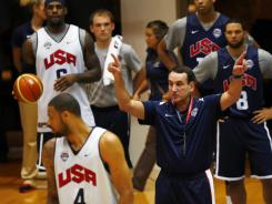 U.S. coach Mike Krzyzewski talks to his team during training at the Smith Center at George Washington University on Sunday.
