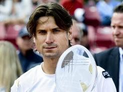 David Ferrer of Spain holds the trophy after compatriot Nicolas Almagro on Sunday in the final of the Swedish Open.