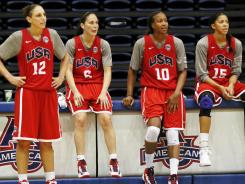 From left to right, guards Diana Taurasi and Sue Bird and forwards Tamika Catchings and Candace Parker watch from the sidelines during training camp Saturday at American University.