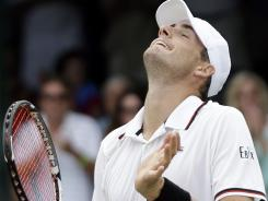 Top seed John Isner of the USA celebrates after defeating Lleyton Hewitt of Australia on Sunday in the final of the Hall of Fame Tennis Championships in Newport, R.I.
