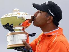 Jeev Milkha Singh of India kisses the trophy after winning the Scottish Open on Sunday in Inverness, Scotland.