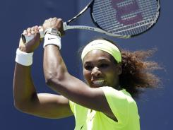 Serena Williams follows through on a backhand Sunday during her victory against fellow American CoCo Vandeweghe in the Bank of the West Classic in Stanford, Calif.