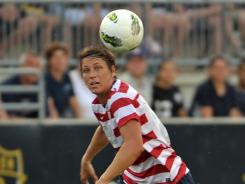Abby Wambach, 32, won a gold medal in women's soccer at the 2004 Athens Olympics but missed the 2008 Beijing Games with a broken leg.