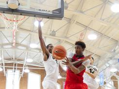 Inside and outside: James Young, right, facing USA West's Marcus Lee on Friday, was 5-for-10 on three-point attempts Sunday.