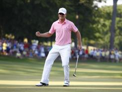 Zach Johnson celebrates his victory Sunday in the John Deere Classic with a birdie on the second hole of a playoff. It's his second win of the season.