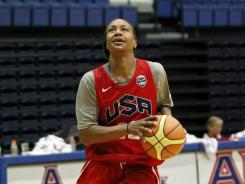 Tamika Catchings goes for a layup during team training at Bender Arena on the campus of American University in Washington on Saturday.