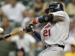 St. Louis Cardinals' Allen Craig hits an RBI single against the Milwaukee Brewers in the ninth inning.