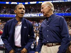 President Obama, left, and vice president Joe Biden take their seats at the Verizon Center in Washington as the U.S. men's basketball team prepares to play Brazil in an Olympic tuneup.