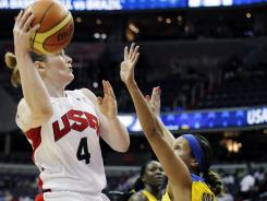 Team USA point guard Lindsay Whalen scores on a layup past Brazil guard Adriana Moises Pinto for two of her 21 points.