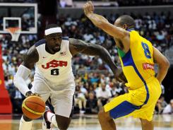 LeBron James, left, driving to the basket against Brazil, scored 30 points to help Team USA rally for an 80-69 win Monday in Washington.