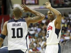 United States forward Kevin Durant (5) high fives United States forward Kobe Bryant (10) against team Brazil in the second half at Verizon Center. Team USA won 80-69.