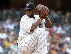 New York Yankees pitcher CC Sabathia throws a pitch during the first inning of a game against the Toronto Blue Jays.