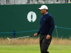 Tiger Woods gets in some practice on the 18th green on Tuesday in advance of the British Open Championship at Royal Lytham & St. Annes.