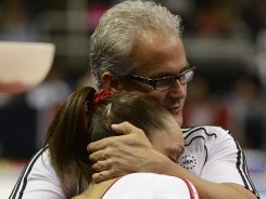 Jordyn Wieber gets a hug from coach John Geddert after her balance beam performance at the U.S. Olympic Gymnastics Team Trials.