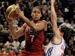 Maya Moore, left, looking to make a move around Great Britain guard Stef Collins, scored a team-high 18 points to lead the USA to an 88-63 win.