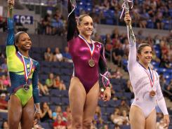 Gabby Douglas, left, Jordyn Wieber, center, Aly Raisman, right, along with teammates Kyla Ross and McKayla Maroney will be the first gymnasts to grace the Sports Illustrated cover since Kerri Strug on Dec. 18, 1996.
