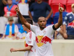 Thierry Henry celebrates his 10th goal of the season, and his first since April 28.