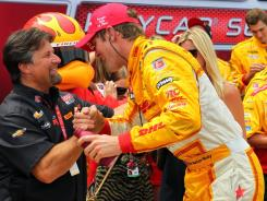 IndyCar series driver Ryan Hunter-Reay celebrates a victory with team owner Michael Andretti during the Honda Indy Toronto.