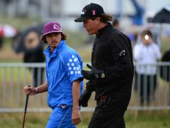 Phil Mickelson, right, walking up No.18 at Royal Lytham & St. Annes with Rickie Fowler during practice Wednesday, says he is more comfortable playing links golf than he was a few years ago.