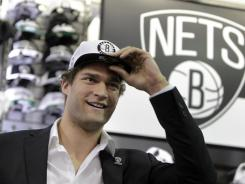 Brook Lopez, the centerpiece in a rumored trade for the Orlando Magic's Dwight Howard, said he never wavered and always has wanted to be with the Nets in Brooklyn.