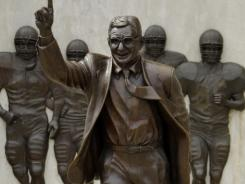 Three Penn State students have vowed to camp out nightly near the statue of late football coach Joe Paterno to guard it against vandalism.