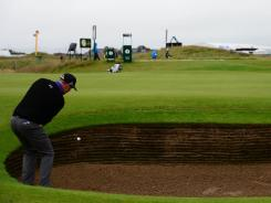 Hunter Mahan of the United States hits a bunker shot during a practice for the British Open, which begins Thursday. There are 205 bunkers on the course at Royal Lytham & St. Annes.
