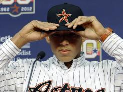 The Houston Astros selected Carlos Correa, 17, as the No. 1 overall pick in the MLB draft.