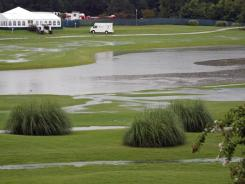 The fairways of holes nine, foreground and 18, background, stand flooded after a torrential afternoon rain passed through Thursday, suspending the first round of the True South Classic.