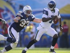 Luis Castillo, seen here chasing down Seattle quarterback Tarvaris Jackson, was released from the Chargers on Thursday.