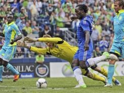 Seattle Sounders goalkeeper Bryan Meredith leaps but is unable to stop Chelsea's Romelu Lukaku who scored two goals in the English club's 4-2 win.