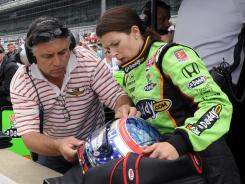 Danica Patrick gets help from her father T.J. during practice for the Indianapolis 500 in 2010.