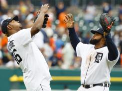 Tigers closer Jose Valverde and first baseman Prince Fielder celebrate after Detroit topped the Angels.