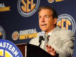 Alabama Crimson Tide coach Nick Saban speaks at a press conference during the final day of the 2012 SEC media days event.