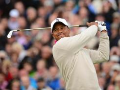 Tiger Woods tees off on the fifth hole during the first round of the British Open at Royal Lytham &amp; St. Annes.